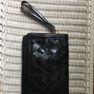 Black leather clutch with cross stitch pattern